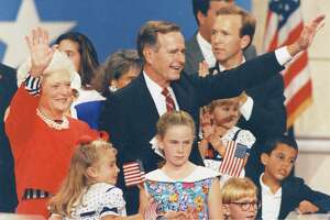 08/19/1992 - Pres. George H.W. Bush joins his wife, Barbara, and their grandchildren on the podium during the third night of the 1992 Republican National Convention in the Houston Astrodome. First Lady Barbara Bush had just addressed the convention with a seven-minute speech that emphasized family values of integrity, strength, pride, and glowing references to her husband. President Bush made a surprise appearance at the convention after the speech Wednesday night.