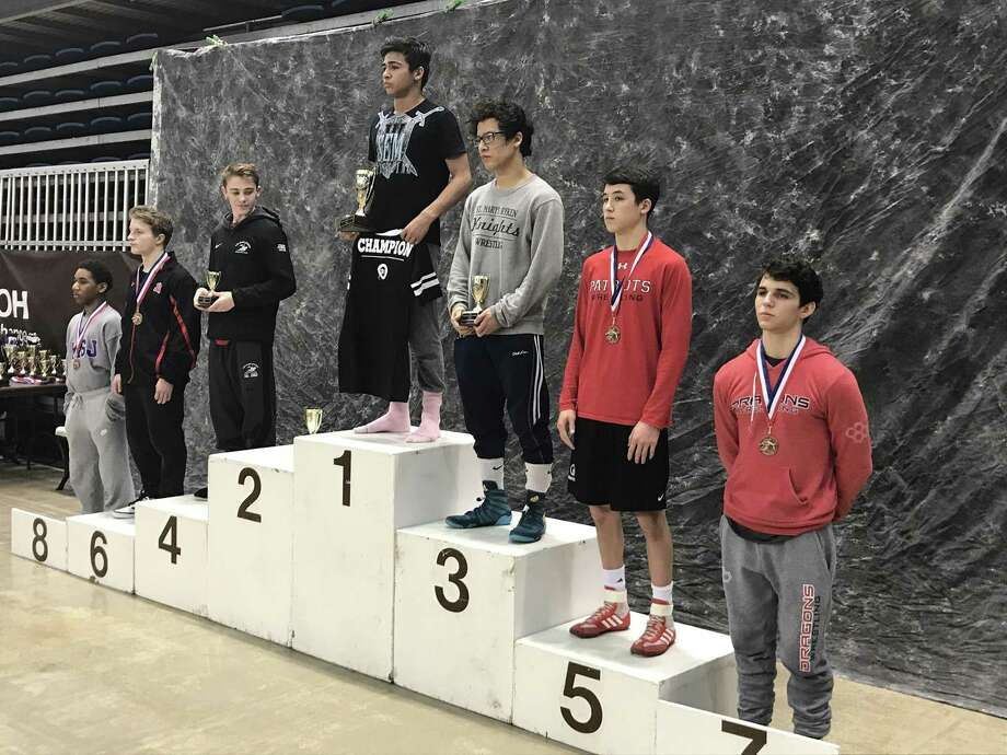Greens Farms Academy junior Griffin Seyfried, far right, placed seventh at the US Prep School Nationals over the weekend, becoming the first Dragon wrestler to earn All-American status since coach Jack Conroy in 2005. Photo: Contributed Photo