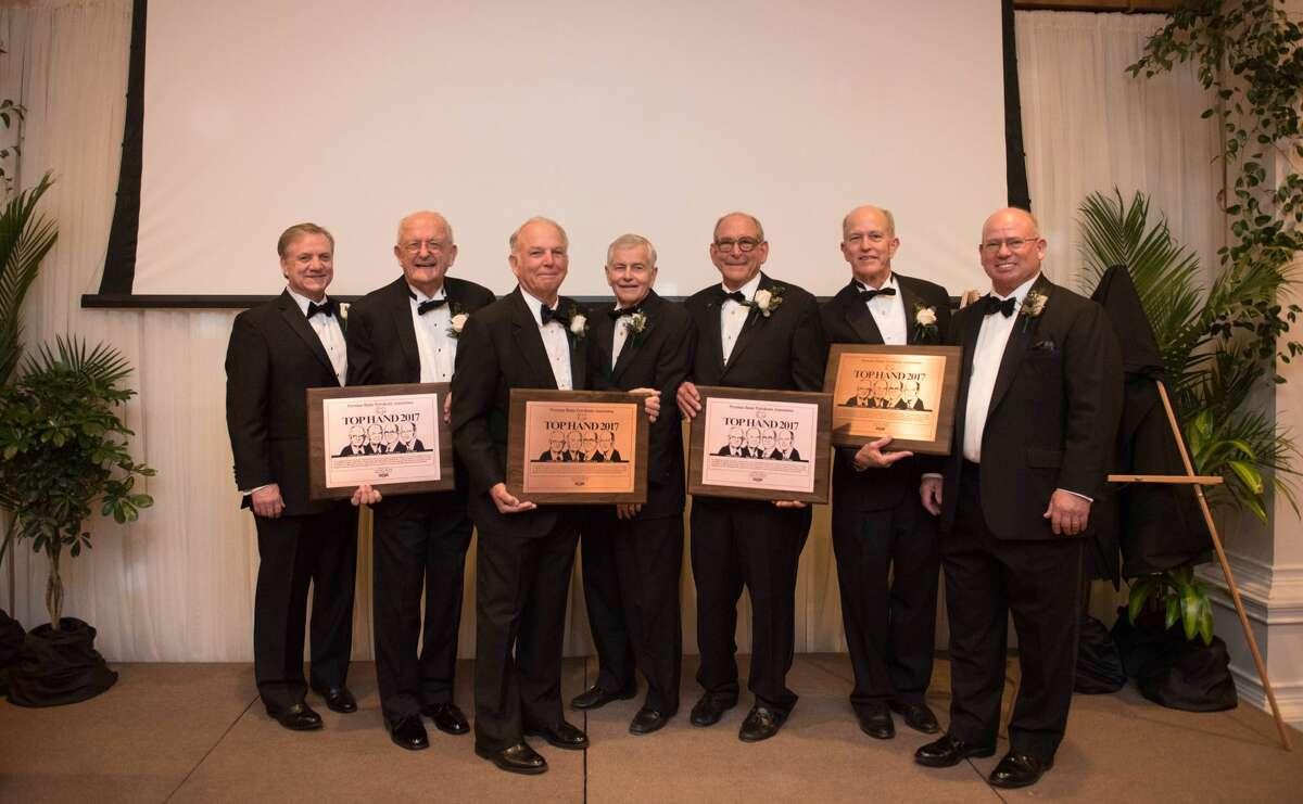 Top Hand: Ben Shepperd, from left, Carty Beal Jr., Barry Beal, Tom Craddick, Spencer Beal, Kelly Beal and Clint Walker