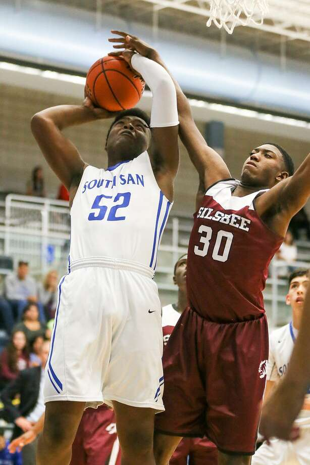 South San's Jon McIntyre (left) is fouled by Silsbee's Decoby Jones as he goes to the basket during the second half  their semifinal game in the 2017 South San Antonio Bobcat Boys Varsiy Basketball Tournament game at the South San Athletic Center on Saturday, Dec. 2, 2017.  South San lost to Silsbee 73-59 but later came back to beat MacArthur 52-50 in the third-place game.  MARVIN PFEIFFER/mpfeiffer@express-news.net Photo: Marvin Pfeiffer, Staff / San Antonio Express-News / Express-News 2017