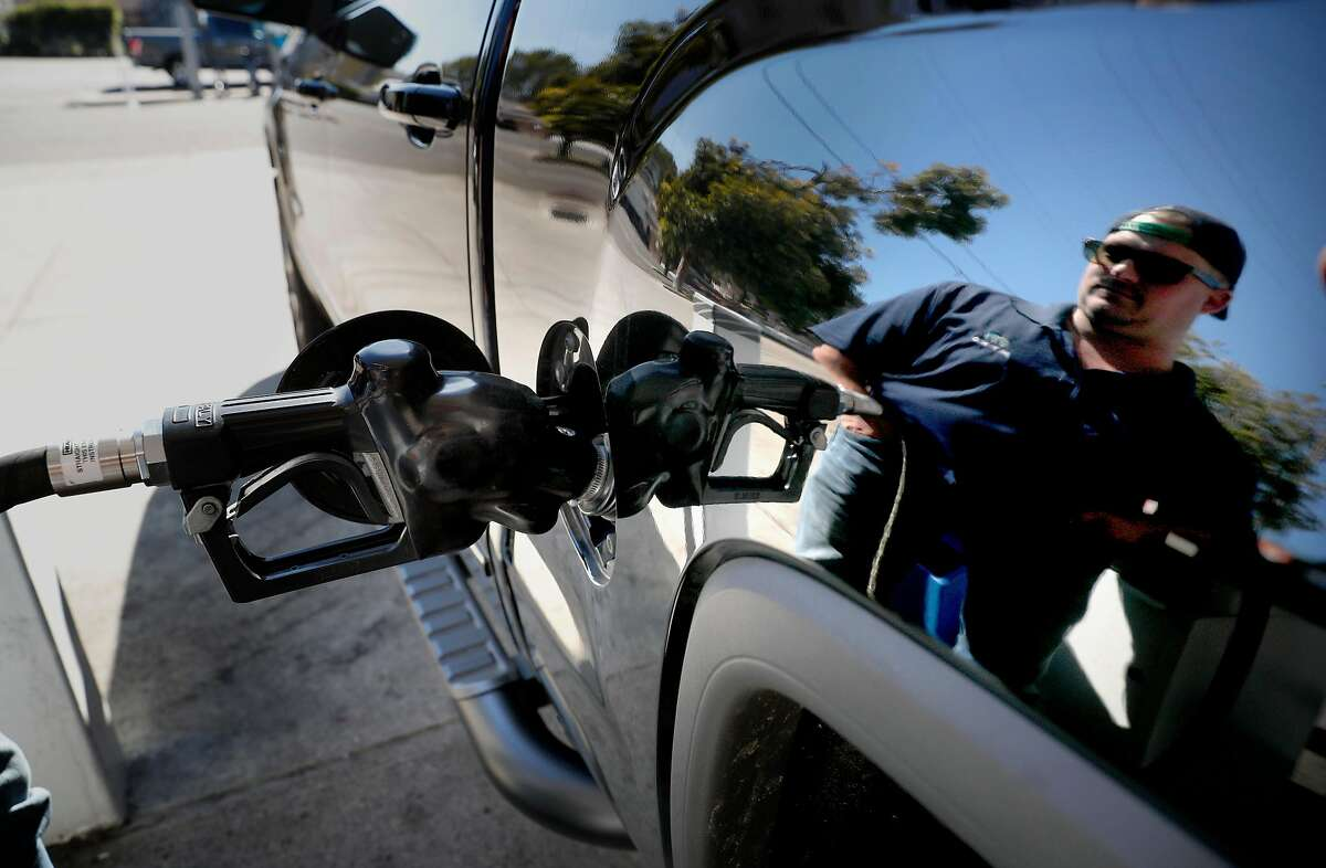 Bobby Pohl of Walnut Creek fills up his truck at a gas station in Oakland, Calif., on Fri. Feb. 23, 2018.