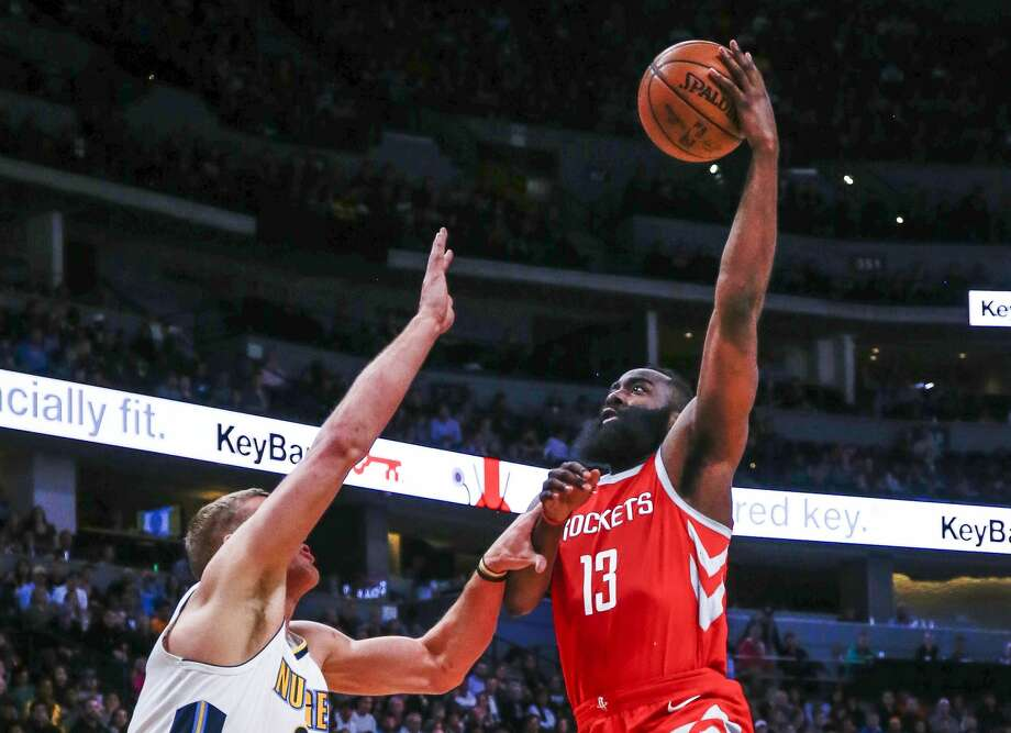 Houston Rockets guard James Harden (13) goes up to shoot against Denver Nuggets center Mason Plumlee (24) and Malik Beasley (25) during the second quarter of an NBA basketball game, Sunday, Feb. 25, 2018, in Denver. (AP Photo/Jack Dempsey) Photo: Jack Dempsey/Associated Press