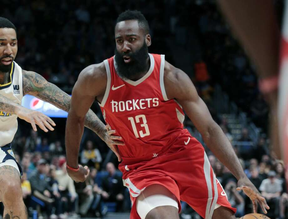 Houston Rockets guard James Harden drives to the basket against Denver Nuggets forward Wilson Chandler (21) during the first quarter of an NBA basketball game, Sunday, Feb. 25, 2018, in Denver. (AP Photo/Jack Dempsey) Photo: Jack Dempsey/Associated Press