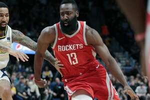 Houston Rockets guard James Harden drives to the basket against Denver Nuggets forward Wilson Chandler (21) during the first quarter of an NBA basketball game, Sunday, Feb. 25, 2018, in Denver. (AP Photo/Jack Dempsey)