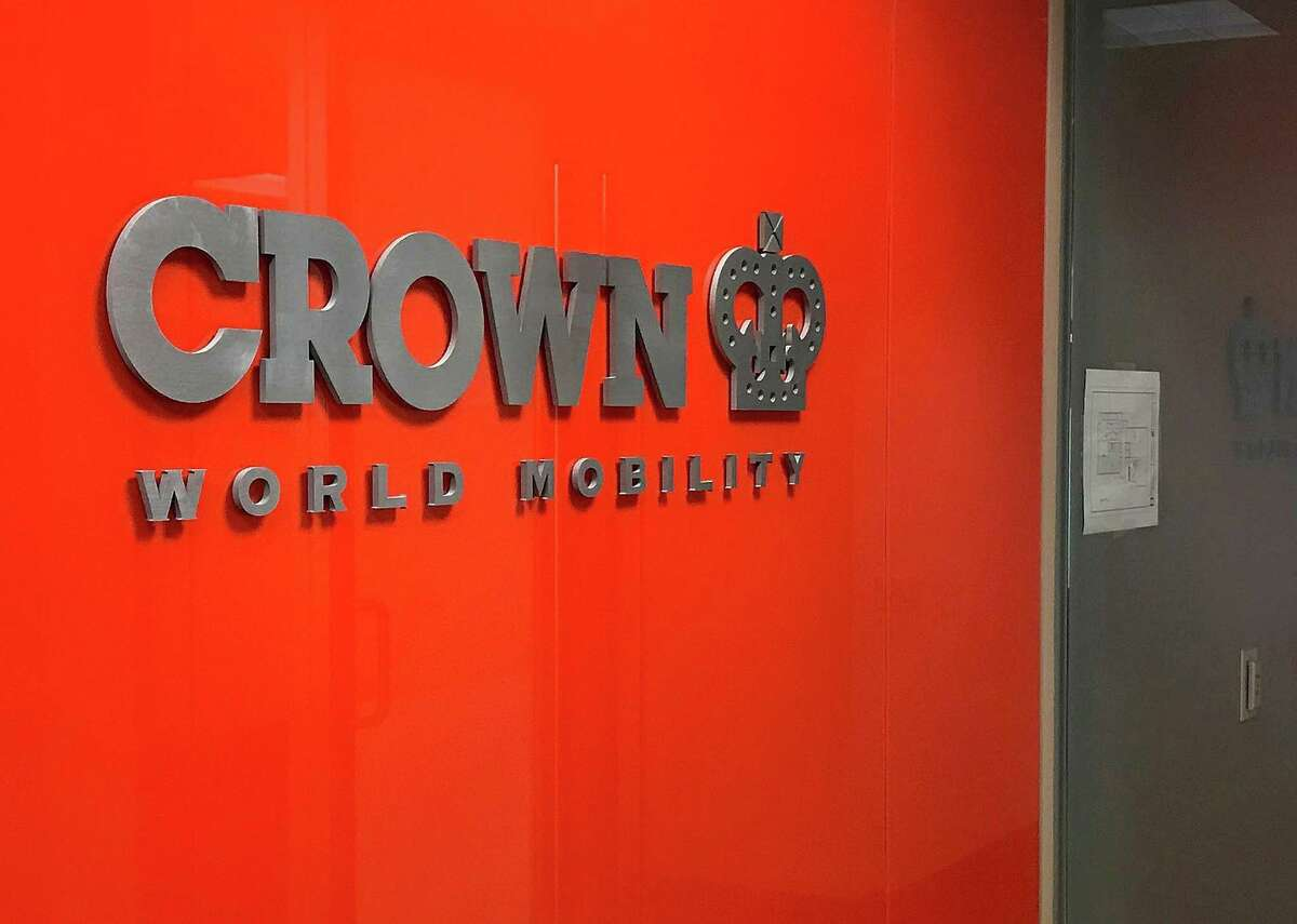 A sign greets visitors at the entrance to Crown World Mobility in Danbury, Conn., on Monday, Feb. 26, 2018.
