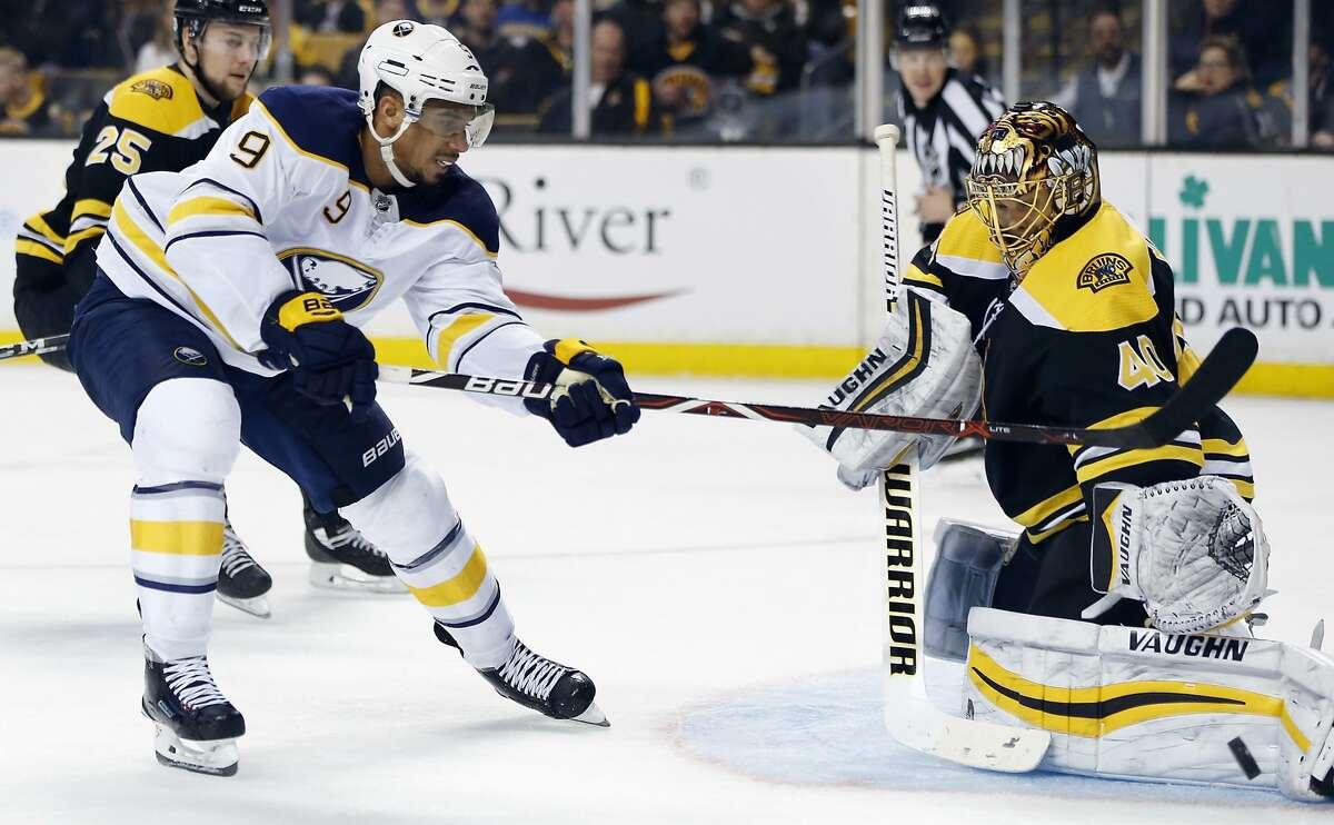 Boston Bruins' Tuukka Rask (40), of Finland, blocks a shot by Buffalo Sabres' Evander Kane (9) during the third period of an NHL hockey game in Boston, Saturday, Feb. 10, 2018. The Sabres won 4-2. (AP Photo/Michael Dwyer)