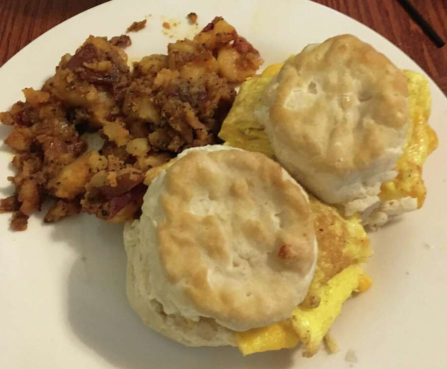 Eggs in a fluffy biscuit and spicy home fries at The Pigeon Hole in Charlottesville, Virginia. Photo: Photo By Debra Bruno For The Washington Post. / For The Washington Post