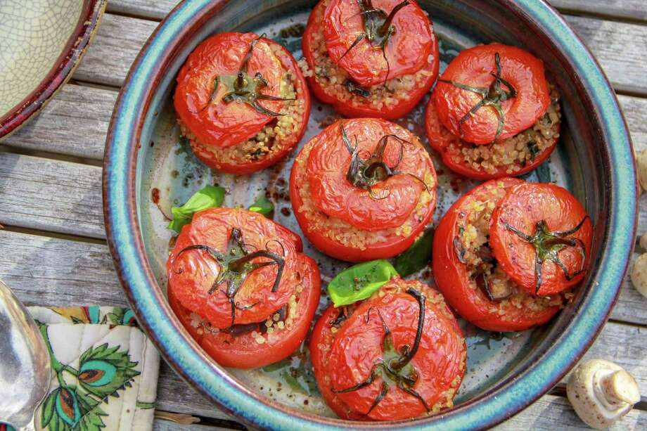 This Jan. 31, 2018 photo shows quinoa-stuffed tomatoes in Bethesda, Md. This dish is from a recipe by Melissa d'Arabian. (Melissa d'Arabian via AP) Photo: Melissa D'Arabian, UGC / Melissa d'Arabian