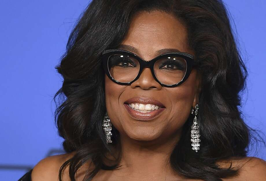 FILE - In an interview, Oprah Winfrey spoke about how being generous with others makes her happy. The talk show host discussed how once when staying in a hotel, she hid money around her hotel room for her housekeeper. Photo: Jordan Strauss, Associated Press