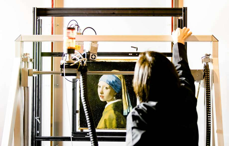 "Johannes Vermeer's ""Girl With a Pearl Earring"" painting is inside an XRF macro-scanner during research at Mauritshuis. Photo: BART MAAT, AFP/Getty Images"