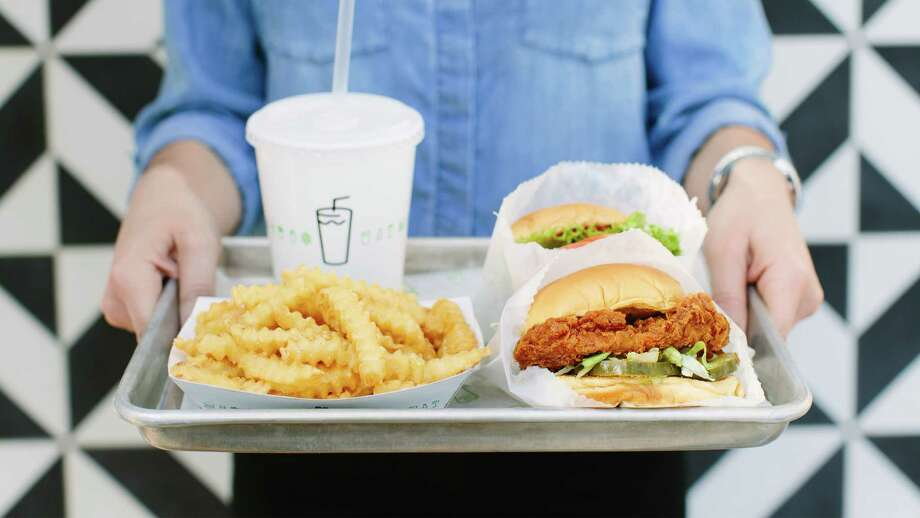 A tray of burgers at a Shake Shack location. Photo: Shake Shack