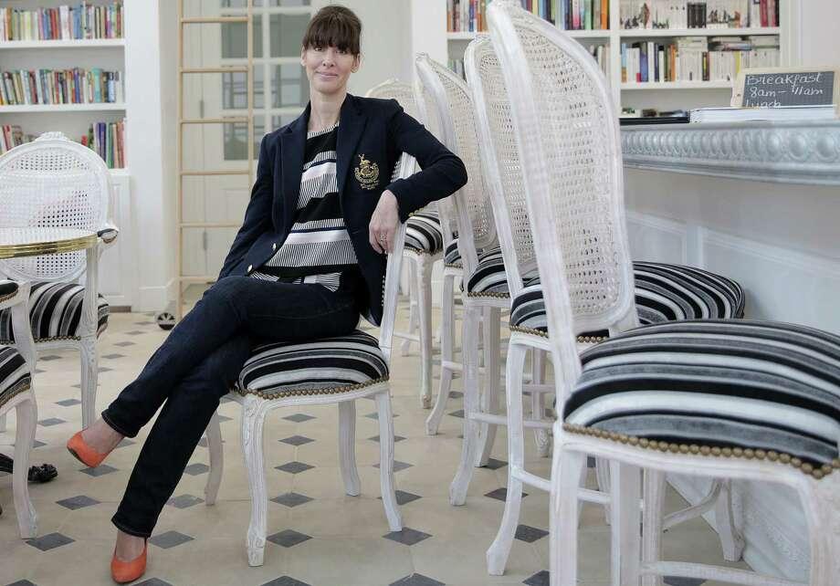 Café Poêtes owner Karine Favre-Massartic Photo: Elizabeth Conley, Chronicle / © 2018 Houston Chronicle