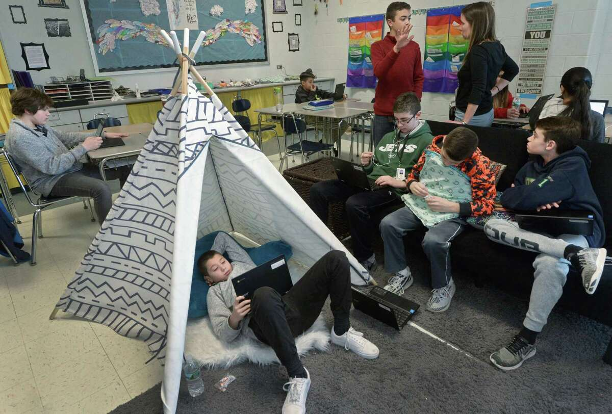 Shelton Intermediate School seventh-graders, including Jake Gigliotti, lower left, study for an exam in the School of Innovation wing Tuesday.