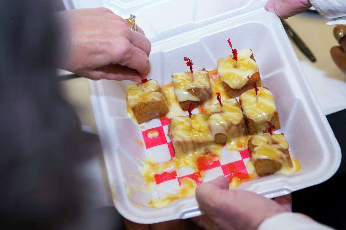 Desserts are distributed during the judging of the Gold Buckle Foodie Awards in the Main Club of NRG Center, Monday, Feb. 26, 2018, in Houston. Judges tasted food that is available to the general public throughout the carnival and rodeo in several categories from