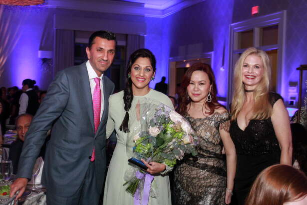 """Honorees Ajay and Sippi Kjurana, from left, being recognized by Tammy Tran Nguyen and Amy Pierce at the KnowAutism """"Reach for the Stars"""" gala."""