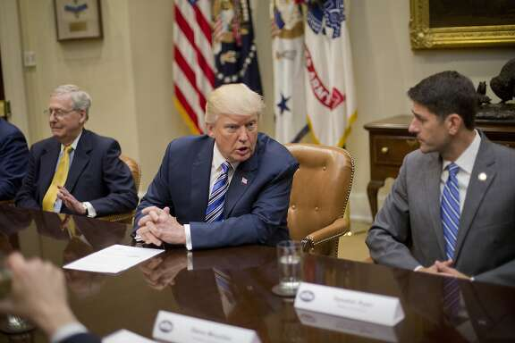 President Donald Trump, center, talks with House Speaker Paul Ryan of Wis., right, during a meeting with House and Senate Leadership in the Roosevelt Room of the White House in Washington, Tuesday, June 6, 2017. Also at the meeting is Senate Majority Leader Mitch McConnell of Ky., left. (AP Photo/Pablo Martinez Monsivais)