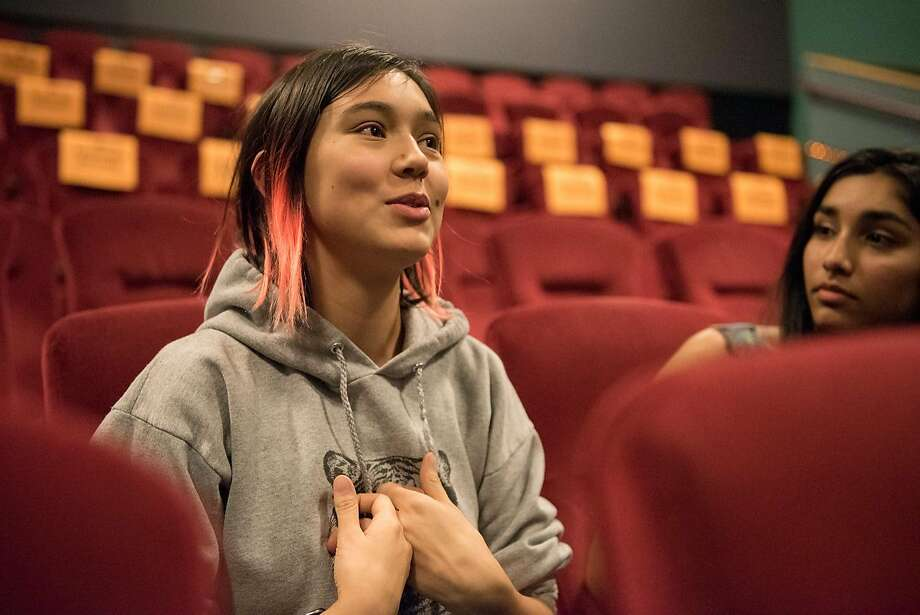 """Annette Vergara-Tucker, 16, discusses her experience as an LGBTQ teenager with classmates from Lick Wilmerding High School, after the advance screening of """"Love, Simon"""" in San Francisco on February 13, 2018. Photo: Rosa Furneaux, Special To The Chronicle"""