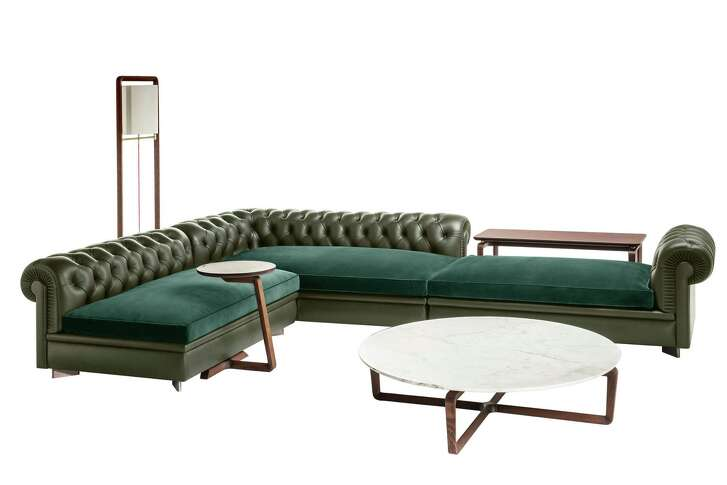 The Poltrona Frau sectional sofa is from its Chester Line. Poltrona Frau is an Italian modern luxury furniture maker whose goods are available in Houston at CASA at West Avenue.