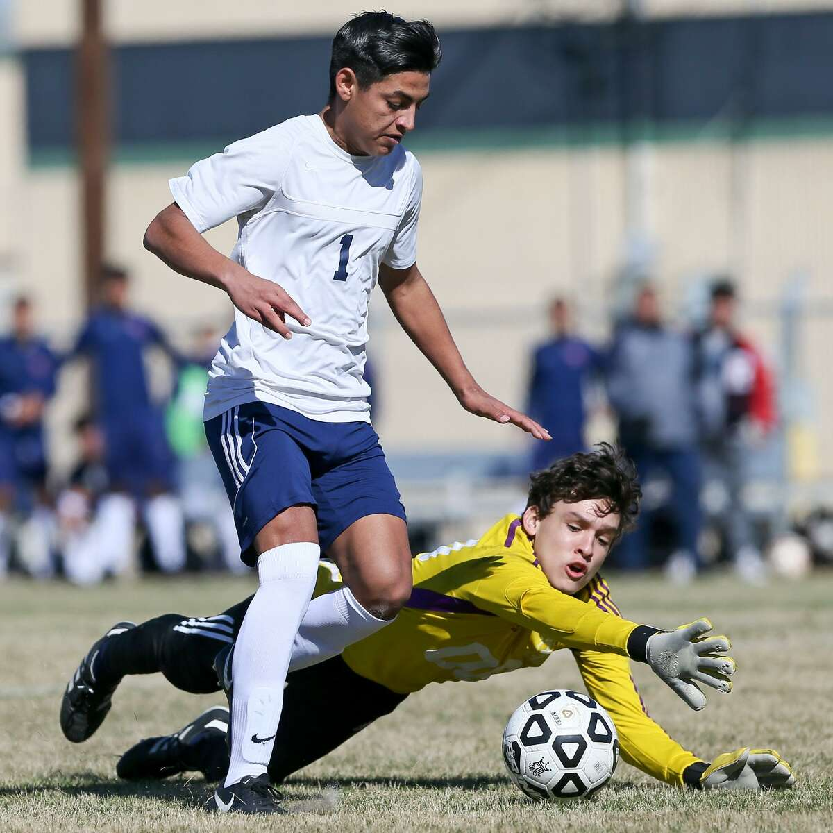 Roosevelt's Carlos Alvarez slips past Central Catholic goalkeeper Alejandro Chavarria as he drives to the goal during the second half of their high school boys soccer game in the 2018 North East Boys Soccer Tournamemt at Blossom Athletic Center East on Saturday, Jan. 13, 2018. Central Catholic beat Roosevelt 3-0. MARVIN PFEIFFER/mpfeiffer@express-news.net