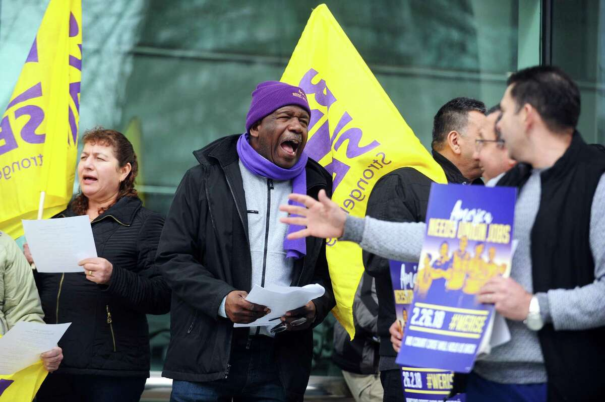 Alberto Bernardez, the assistant supervisor for SEIU 32 BJ, energizes the crowd with chants during a rally outside of Government Center in downtown Stamford on Monday.