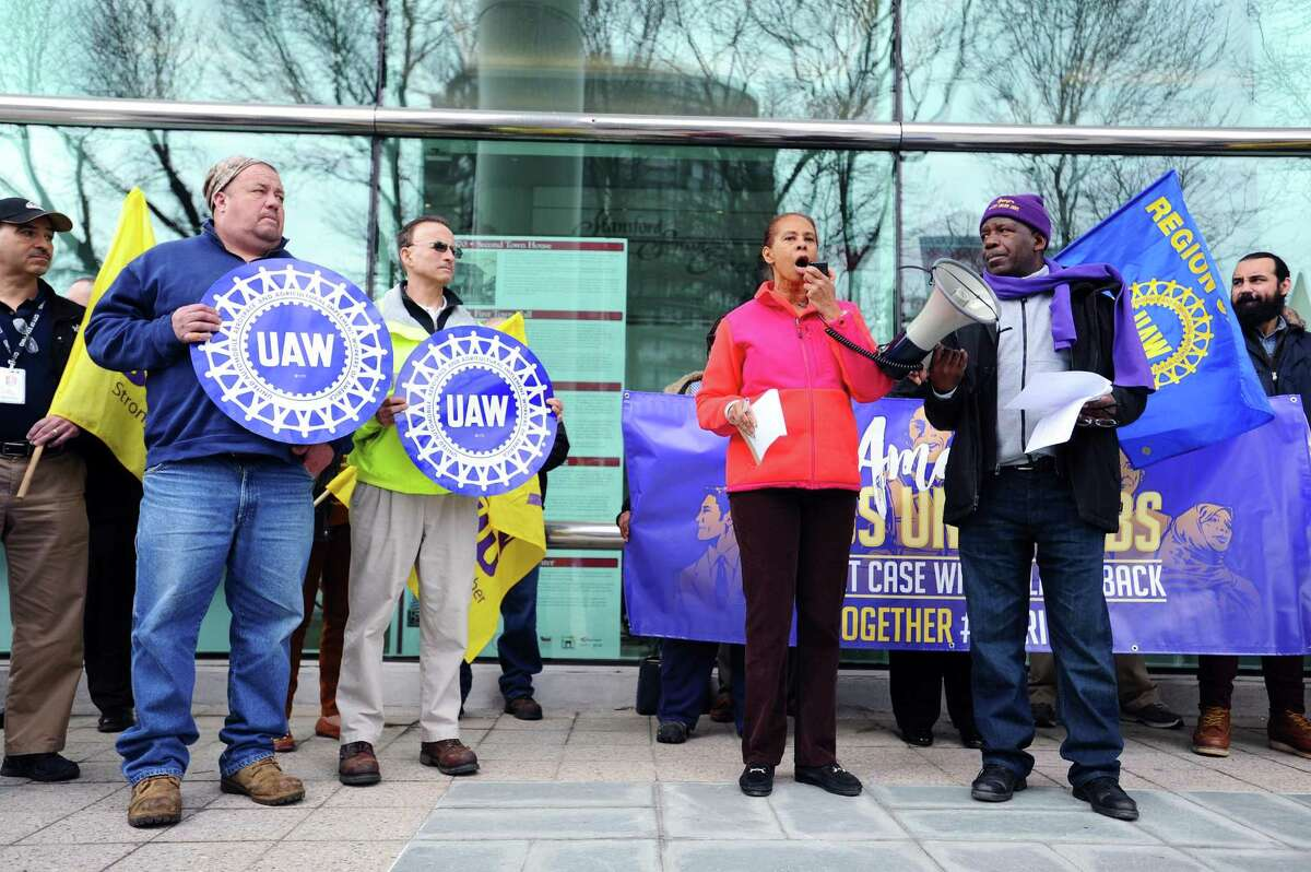 Greenwich domestic worker Cheryl Gidarie, 59, talks about the need for unions during a rally outside of Government Center in downtown Stamford, Conn. on Monday, Feb. 26, 2018. The rally, which occured simultaneously with rallies in Hartford, New Haven and Storrs, was planned to coincide with the beginning of oral arguments in the U.S. Supreme Court case Janus v. AFSCME Council 31, which many in public sector unions fear could strike a potentially fatal blow to unions, public and private, across the country.