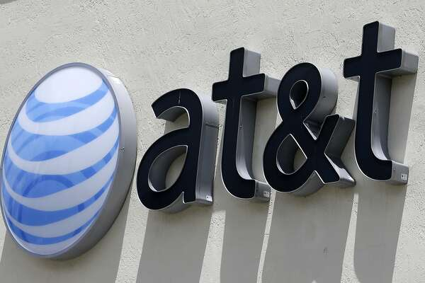 FILE - This July 27, 2017, file photo shows an AT&T logo at a store in Hialeah, Fla. On Monday, Feb. 26, 2018, the 9th U.S. Circuit Court of Appeals said the Federal Trade Commission can indeed punish telecommunications companies for deceptive practices. The FTC still must prove that AT&T was deceptive. The case is over claims that AT&T misled smartphone customers in offering unlimited data plans, but slowing speeds for heavy users. (AP Photo/Alan Diaz, File)