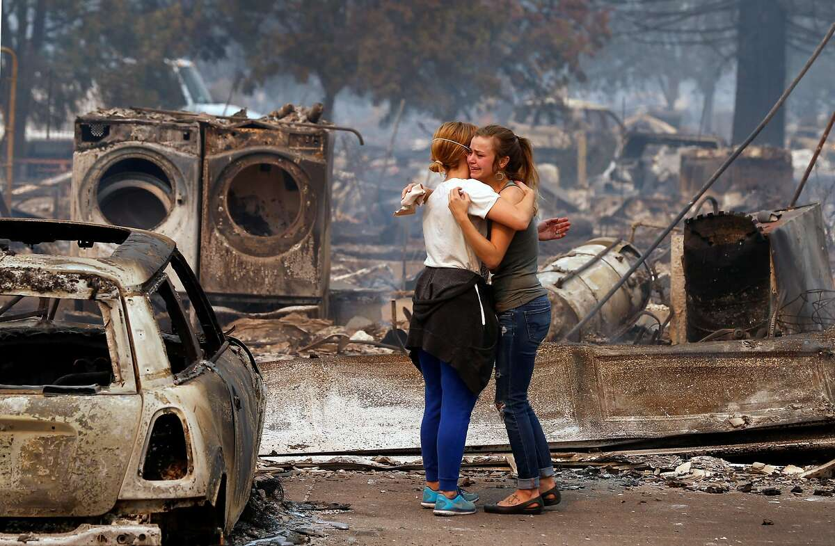 Erica Rinkor, (left) comforts Brandi Burns in front of her destroyed home at the scene of the Tubbs Fire in Santa Rosa, Ca., on Monday October 9, 2017. Massive wildfires ripped through Napa and Sonoma counties early Monday, destroying hundreds of homes and businesses on Monday October 9, 2017
