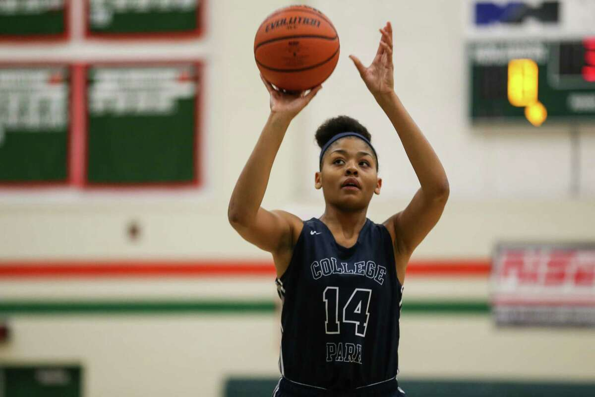 College Park's Sandra Cannady (14) shoots a free-throw during the girls basketball game against The Woodlands on Friday, Jan. 5, 2017, at The Woodlands High School. (Michael Minasi / Houston Chronicle)