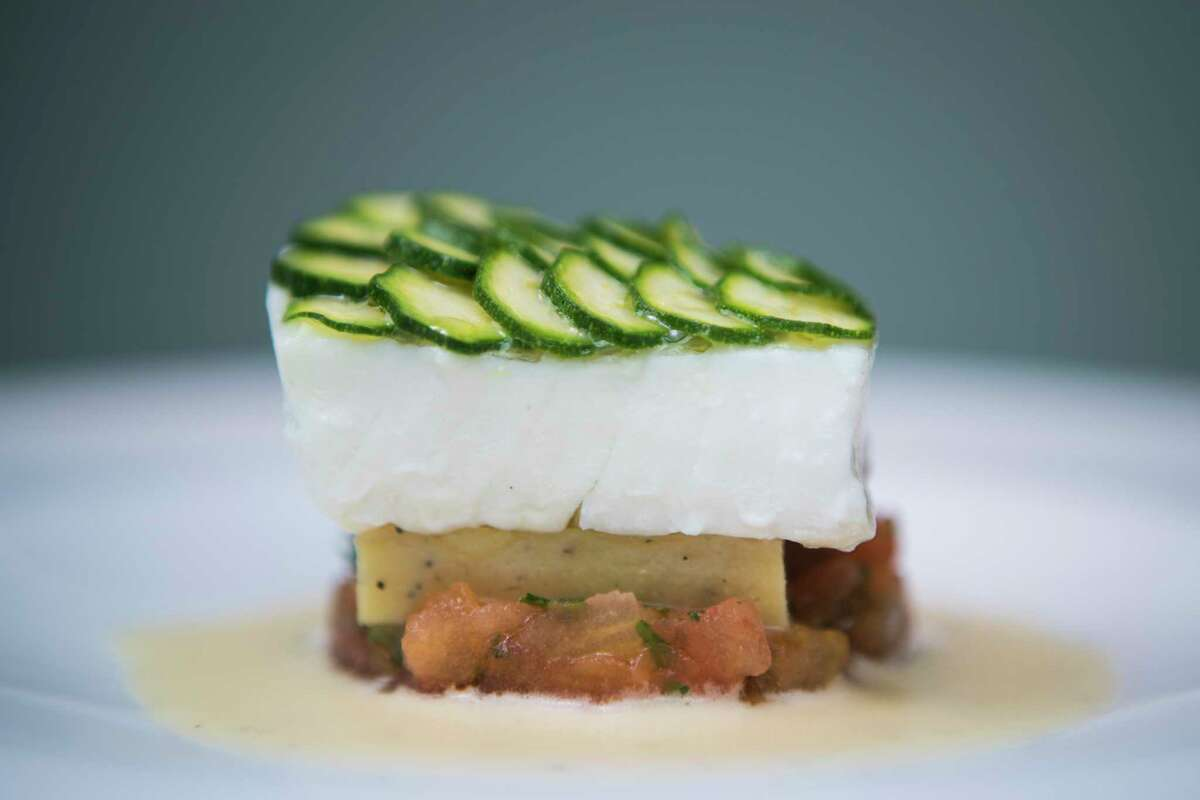 Flounder with zucchini, tomato, panisse and citrus vinaigrette is a dinner-menu showstopper.