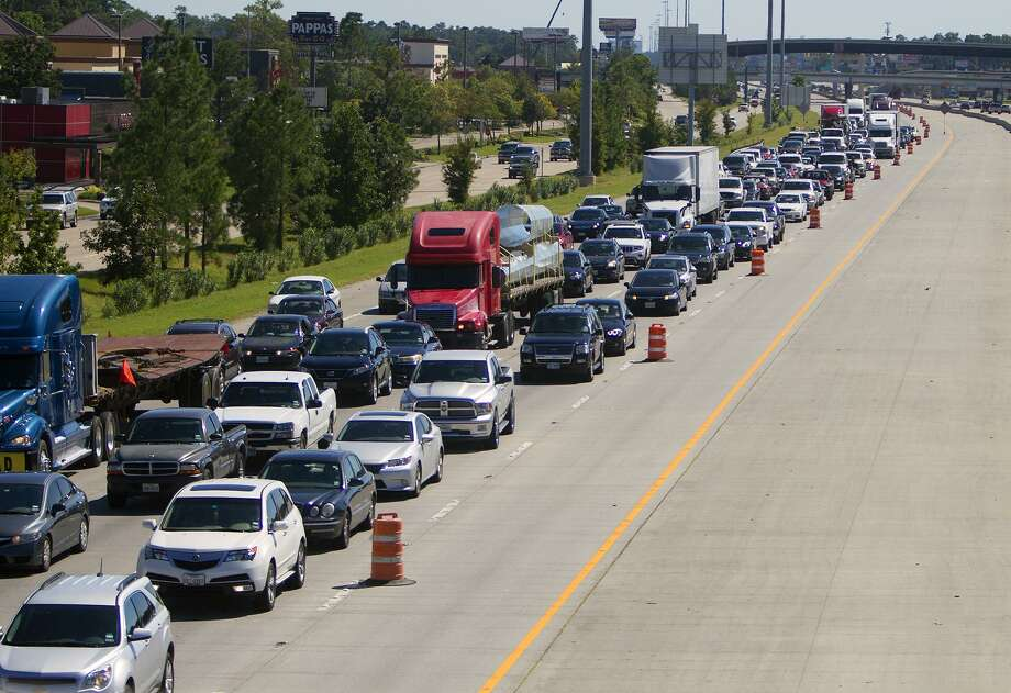 In this 2014 archive photograph, backed up traffic on Interstate-45 plods along. CONTINUE to see how much worse your commute will be in 20 years. Photo: Cody Duty, Staff / Houston Chronicle / © 2014 Houston Chronicle