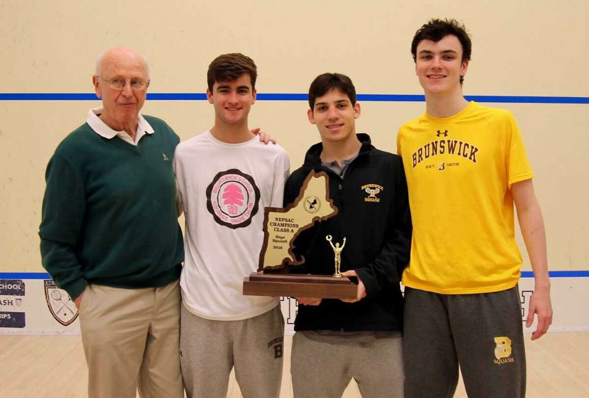 Brunswick squash coach Jim Stephens stands with, from left, tri-captains Patrick Feeley, Max Finkelstein and Will Holey.