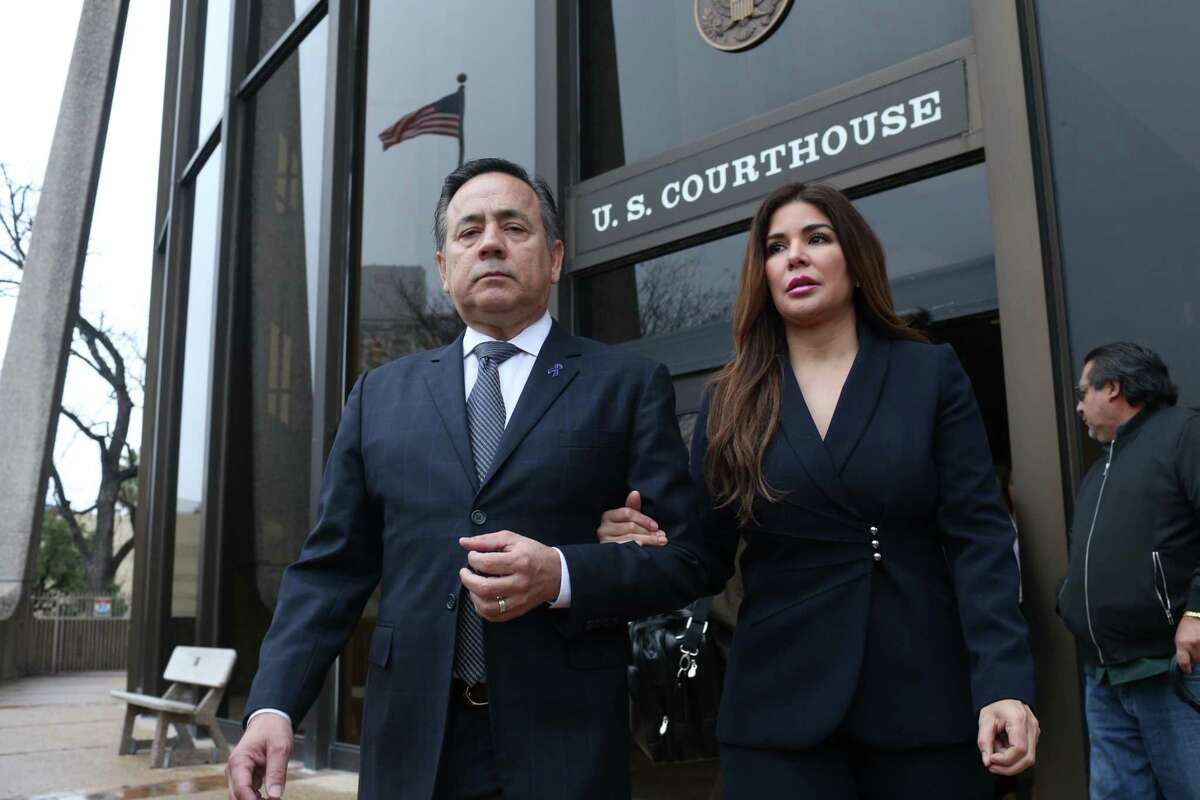 State Sen. Carlos Uresti and his wife Lleanna, leave the San Antonio federal courthouse Thursday following his conviction on 11 felony charges over his roles at a now-defunct oilfield company. He is slated to stand trial in May in a bribery and money laundering case. His co-defendant, Lubbock businessman Vernon C. Farthing III, wants a separate trial.