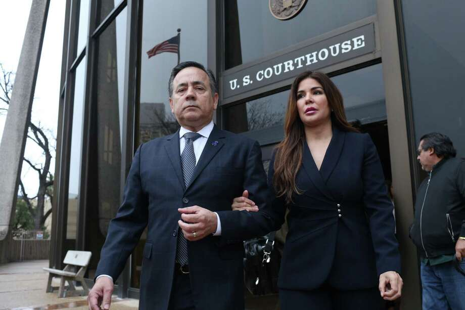 State Sen. Carlos Uresti and his wife Lleanna, leave the San Antonio federal courthouse Thursday following his conviction on 11 felony charges over his roles at a now-defunct oilfield company. He is slated to stand trial in May in a bribery and money laundering case. His co-defendant, Lubbock businessman Vernon C. Farthing III, wants a separate trial. Photo: Jerry Lara /San Antonio Express-News / 2018 San Antonio Express-News