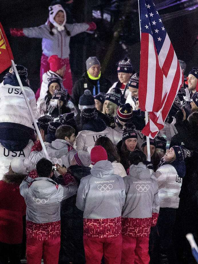 Jessie Diggins carries the flag for Team USA at the Closing Ceremony of the 2018 Pyeongchang Winter Olympics on Sunday, February 25, 2018 in South Korea. (Carlos Gonzalez/Minneapolis Star Tribune/TNS) Photo: Carlos Gonzalez / TNS / Minneapolis Star Tribune