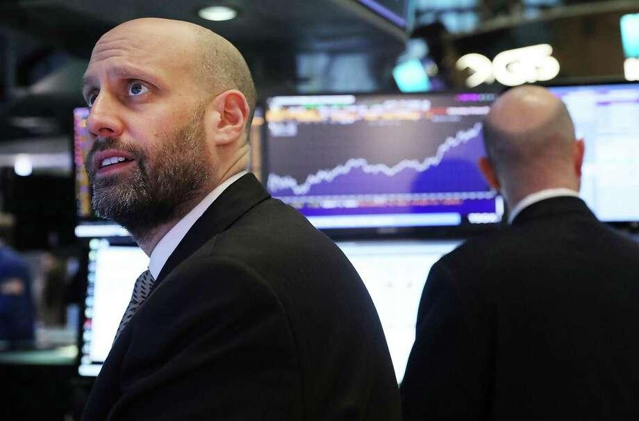 Traders work on the floor of the New York Stock Exchange Monday Photo: Spencer Platt / Spencer Platt / Getty Images / 2018 Getty Images