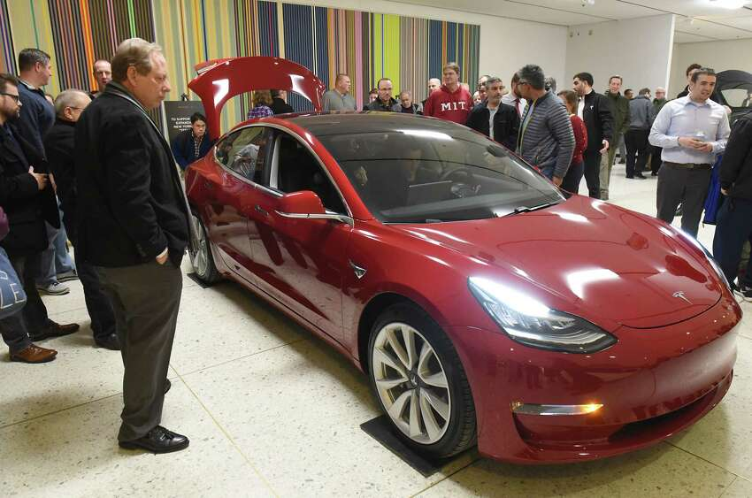 People check out the Model 3 Tesla during TeslaOs Model 3 Road Trip and Policy Forum at the Empire State Plaza Concourse on Monday, Feb. 26, 2018 in Albany, N.Y. (Lori Van Buren/Times Union)