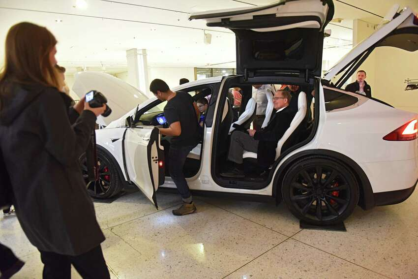 People check out the Model X SUV Tesla during TeslaOs Model 3 Road Trip and Policy Forum at the Empire State Plaza Concourse on Monday, Feb. 26, 2018 in Albany, N.Y. (Lori Van Buren/Times Union)