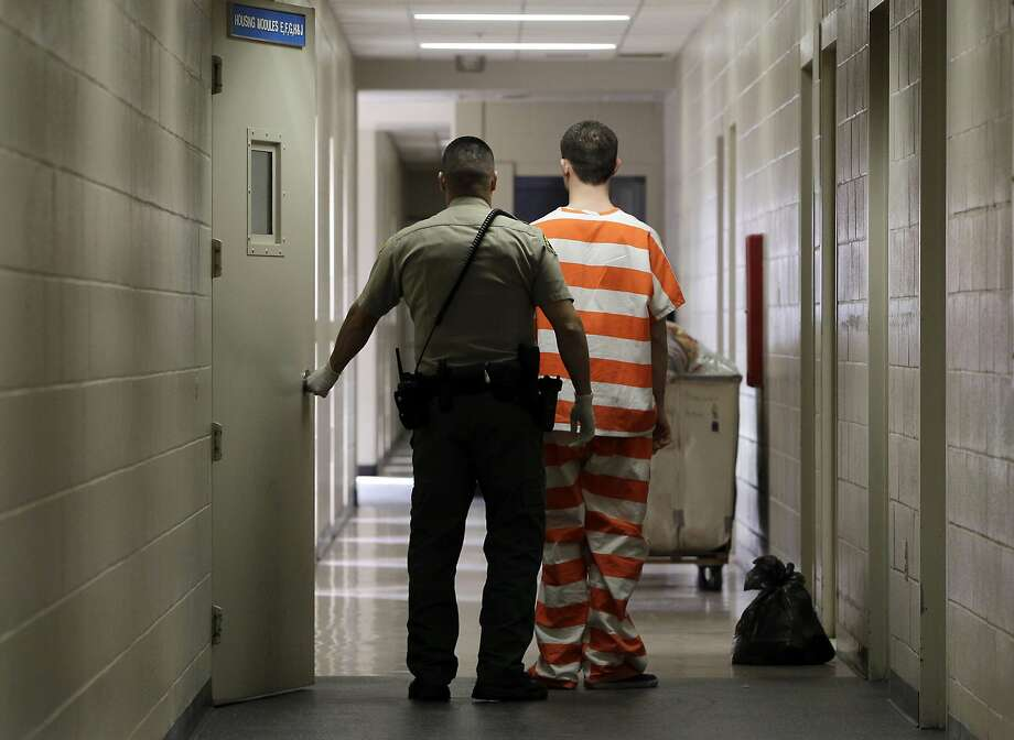 In this Feb. 21, 2013, photo, an inmate at the Madera County, Calif., Jail is taken to an inmate housing unit. The California Supreme Court ruled Monday, Feb. 26, 2018, forbidding juveniles an opportunity for parole for 50 years or more is unconsitutional. (AP Photo/Rich Pedroncelli, File) Photo: Rich Pedroncelli, Associated Press