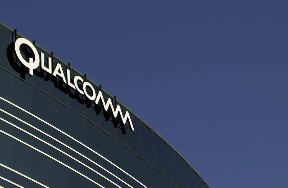 In this Nov. 2, 2011, file photo, a sign sits atop the Qualcomm headquarters building in San Diego. Qualcomm is raising its takeover bid for NXP Semiconductors by nearly 16 percent to about $43.22 billion, citing in part NXP's strong results since the companies first announced their merger in October 2016. The move announced Tuesday, Feb. 20, 208, comes as Qualcomm itself is in the crosshairs of Broadcom Ltd., which earlier this month raised its own cash and stock bid for Qualcomm to $121 billion. Photo: Gregory Bull / Gregory Bull / Associated Press / AP2011