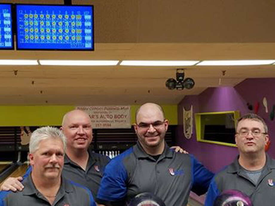 Members of the Walsh Pro Shop team in the Cohoes Businessmen League (from left): Dave Soulter, Darren McGeary, Joe Bifaro Jr. and Tom Walsh Jr. Soulter, Bifaro and Walsh all rolled 300s in the same game Friday, Feb. 23, 2018, at the Cohoes Bowling Arena, tying a national record. (Facebook / Courtesy Darrell Coonrad) Photo: Facebook/courtesy Darrell Coonra