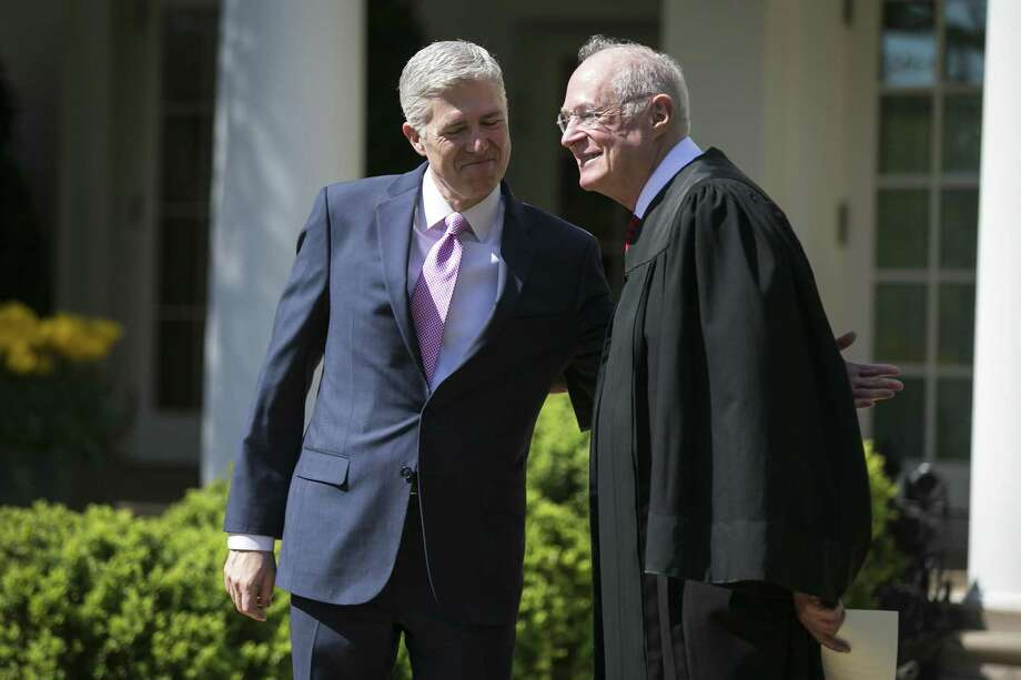 FILE: Judge Neil Gorsuch, left, and Supreme Court Justice Anthony Kennedy during a swearing-in ceremony for Gorsuch to become the 113th justice of the Supreme Court, in the Rose Garden of the White House in Washington, April 10, 2017. Supreme Court justices say they do not act politically when they decide cases. But they freely admit to taking account of politics in deciding when to retire. (Al Drago/The New York Times) Photo: AL DRAGO, STF / NYT / NYTNS