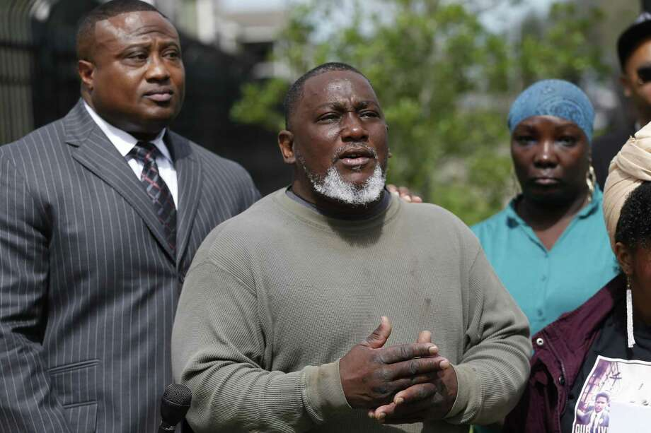 Stephon Arnold's father, David becomes emotional while talking about his son's unsolved murder Monday, Feb. 26, 2018, in Houston. Community Activist Quanell X, tenant activist of the Forum Park Apartments and the family of Stephon Arnold held a press conference to ask for help solving the crime. Police have multiple suspects but no one in the apartment complex will come forth and tell what they witnessed. Photo: Steve Gonzales / Steve Gonzales / Houston Chronicle / © 2018 Houston Chronicle