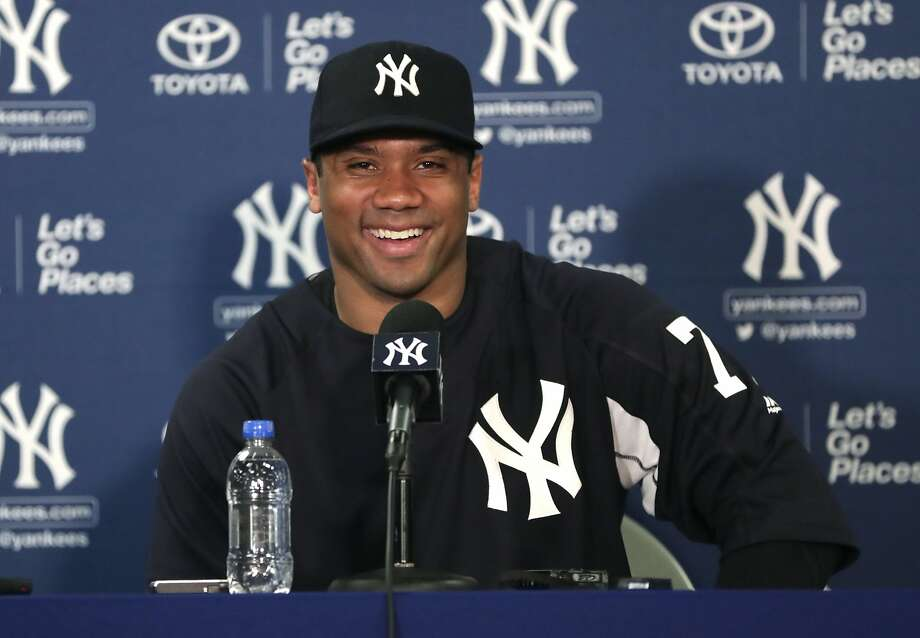 a7438053ebd83 Seattle Seahawks quarterback Russell Wilson smiles during a news conference  at New York Yankees baseball spring