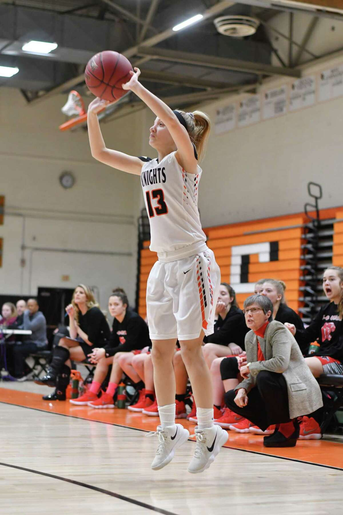 Kelly Jagodzinski (13) of the Stamford Black Knights attempts a three point shot during the Class LL opening round game against the E.O Smith Panthers at Stamford High School on Monday February 26, 2018, in Stamford, Connecticut.