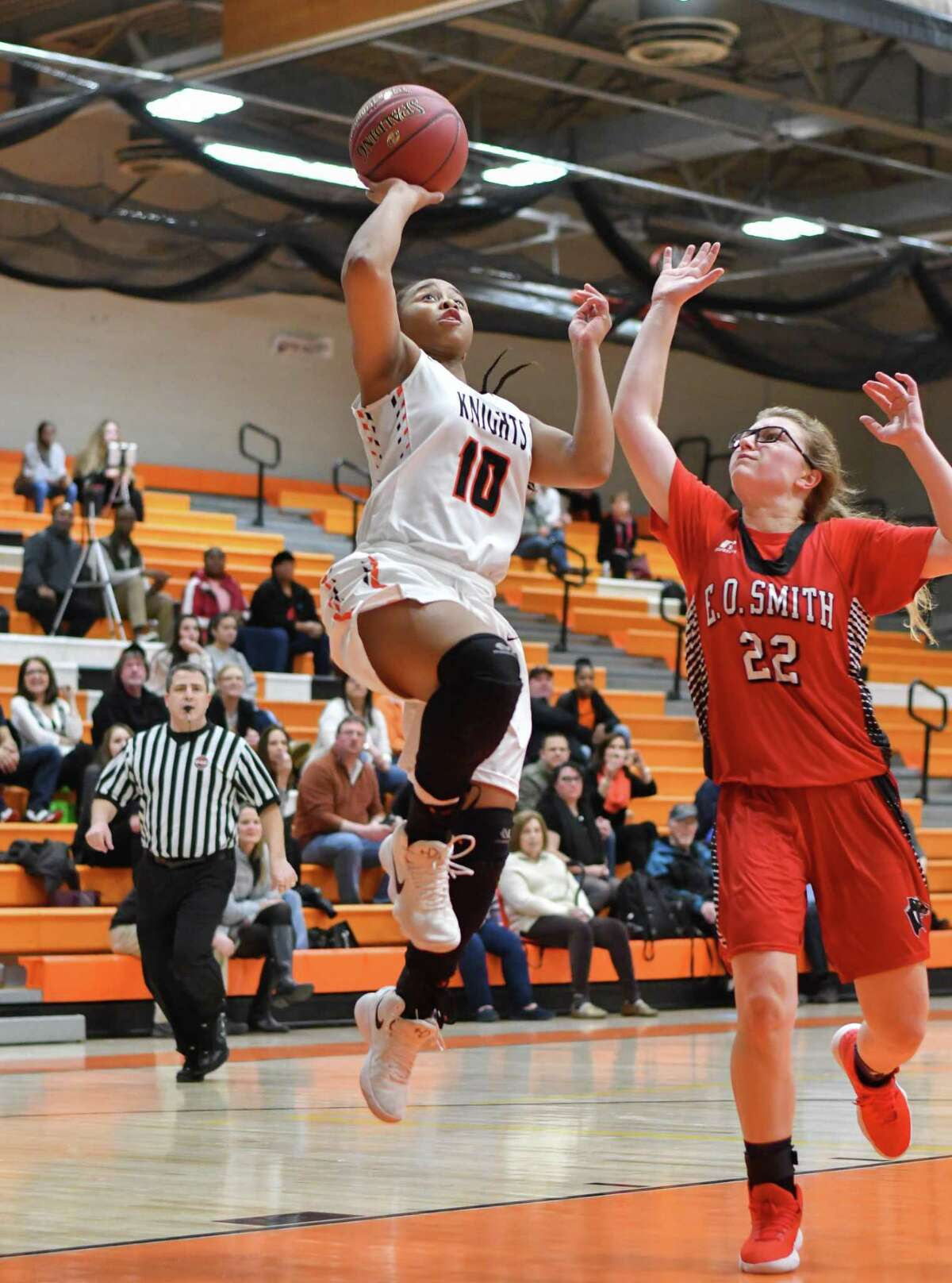Stamford's Jessica Nelson drives to the basket against the E.O Smith Panthers during Monday night's Class LL playoff game.