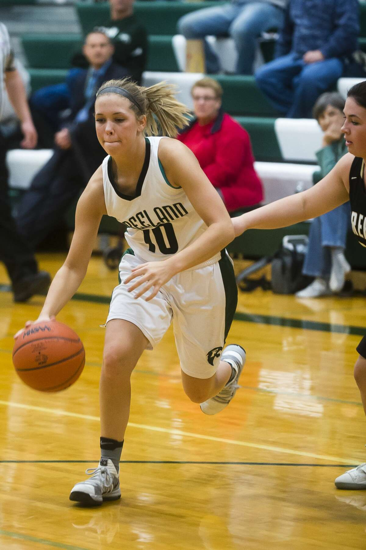 Freeland junior Lily Beyer dribbles toward the basket as Bullock Creek senior Breanna Mieske guards her during their game on Monday, Feb. 26, 2018 at Freeland High School. (Katy Kildee/kkildee@mdn.net)