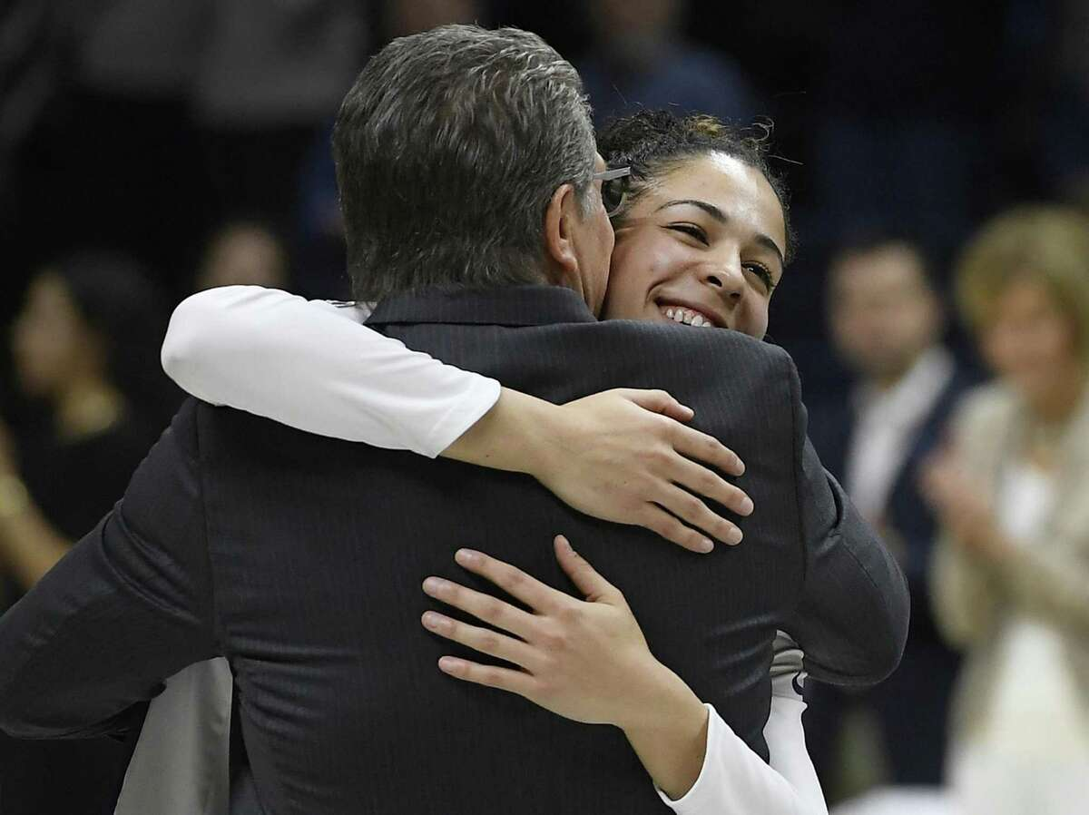 UConn's Kia Nurse, right, hugs head coach Geno Auriemma during a Senior Night ceremony before Monday's game in Storrs.