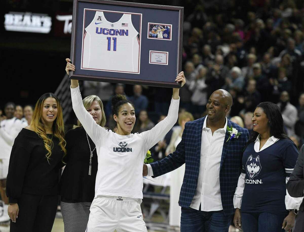 UConn's Kia Nurse holds up a jersey with her number during a Senior Night ceremony before Monday's game in Storrs.