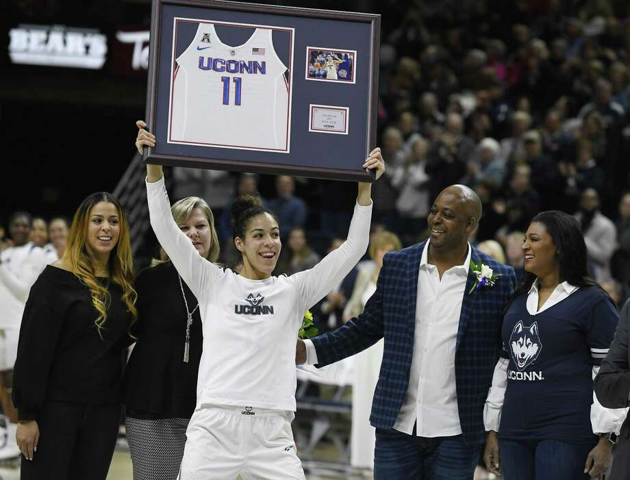 UConn's Kia Nurse holds up a jersey with her number during a Senior Night ceremony before Monday's game in Storrs. Photo: Jessica Hill / Associated Press / AP2018