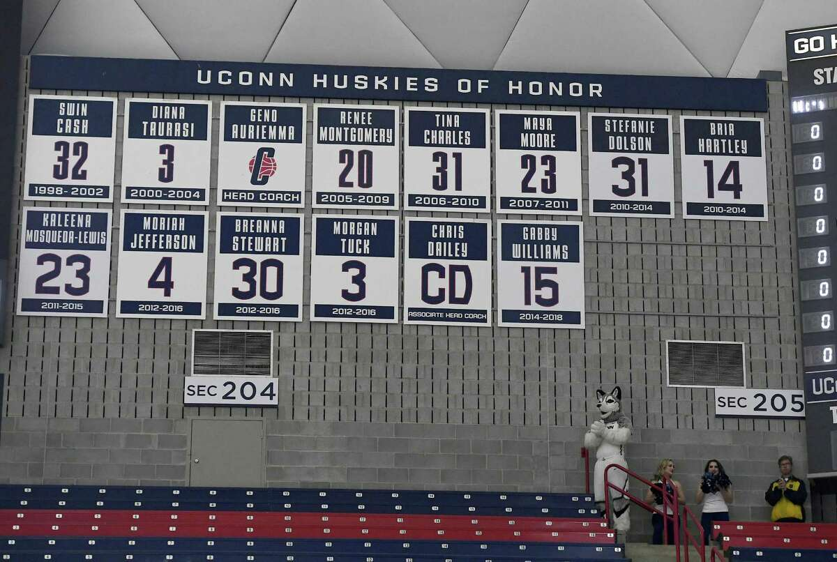 Gabby Williams' No. 15 is revealed on the UConn Huskies of Honor wall before Monday's game in Storrs.
